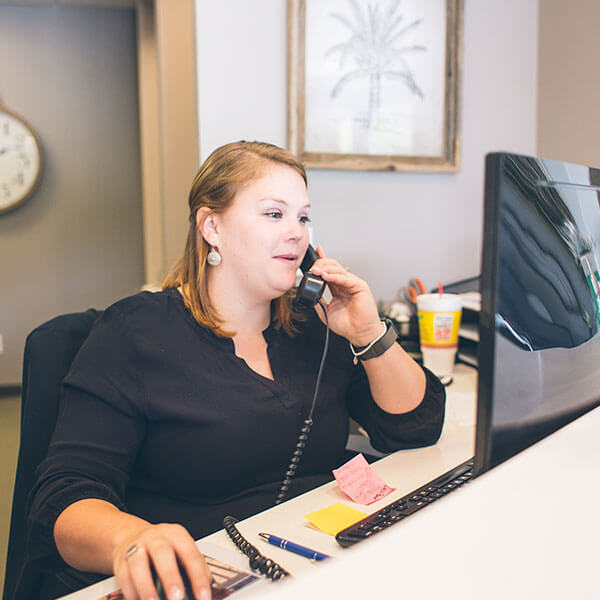 Our Palms Dentistry receptionist answering an emergency dentistry call