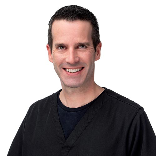 One of our Palms Dentistry dentists, Dr. Jeffrey Weaver, wearing a black shirt and smiling