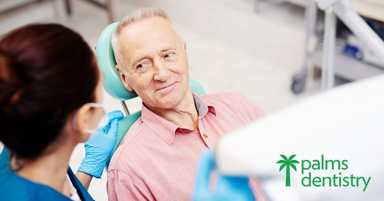 Older man discussing Emergency dentistry treatment options with a dentist